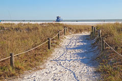 Walkway to Siesta Key Beach in Sarasota, Florida. Walkway to the white sand beach and lifeguard station at Siesta Key Beach near Sarasota, Florida Royalty Free Stock Photography