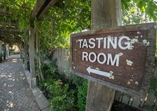Walkway to the wine tasting room. Sign leads you to the tasting room, Napa Valley winery royalty free stock photo