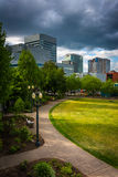Walkway at Tom McCall Waterfront Park and buildings in Portland, Oregon. stock image