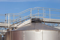 The walkway on top of big industrial tanks farm in refinery indu Royalty Free Stock Photography