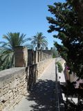 Walkway on Top of Medieval Alcudia Old Town Walls. View along part of the old stone walls that surround the historical old town of Alcudia on the island of Royalty Free Stock Photos