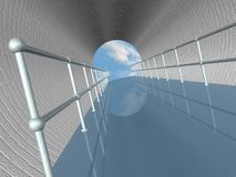 Walkway in Tunnel. Walkway with metal railing in brick tunnel has opening to blue sky and clouds. Wide angle view Royalty Free Stock Photo