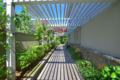 Walkway with veranda like semi open wooden rooftop Stock Images