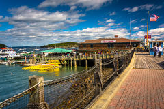 Walkway and view of the harbor in Bar Harbor, Maine. Royalty Free Stock Images