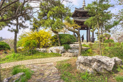 The walkway and a vintage Chinese pavilion in a garden Stock Photo