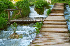 Walkway through waterfall. Wooden walkway along a waterfall stock images