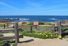Walkways, fence and sign for Asilomar State beach in Pacific Gro Stock Photos