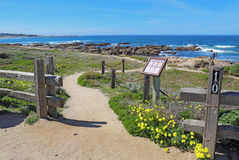 Walkways, fence and sign for Asilomar State beach in Pacific Gro Stock Images