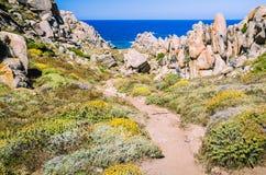 Walky path between bizarre granite rock formations in Capo Testa, Sardinia, Italy Royalty Free Stock Photo
