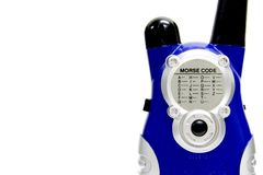 Walky talky. Blue 2-way radio with morse code chart on white background Royalty Free Stock Images