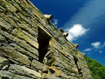 Wall. Old stone wall on a house Royalty Free Stock Photography
