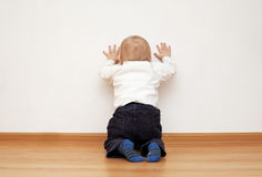 Wall. Little boy near the wall Stock Images
