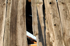 Wall 130. A wooden facade at an old house stock photography
