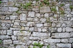 Wall. With large blocks of stone set between them and vegetation stock images