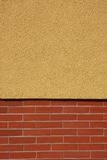 Wall. Closeup of yellow and red bricked wall Stock Image
