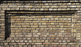 Wall. Fragment of old wall with rectangular indentation Stock Photos