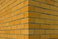 Wall. Corner of a brick wall, yellow brick Stock Image