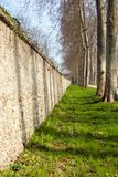 Wall. Along a tree-lined path in the gardens of Versailles, France Stock Image
