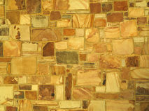 Wall. Warm colored sandstone wall background royalty free stock photography