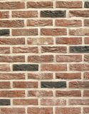 Wall. Old stylized red wall from bricks stock images