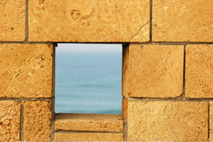 Wall. Bricks wall with window to the sea Stock Photos