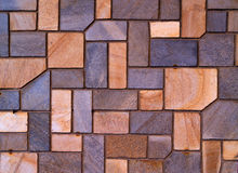 Wall. A wall with colorful geometric stones Stock Image