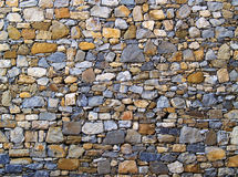 Wall. A wall made of stones of different shapes and colors royalty free stock photos