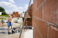 Wall. On construction site. Worker on background. Under construction Stock Image