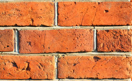 Wall. Red old brick textured wall. Cracked bricks Stock Images