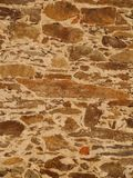 Rustic stone and sand wall Stock Photos