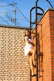 Wall. Girl on fire climbs stairs Stock Images