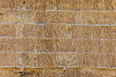 Wall of adobe, earth, mud, straw, pressed. Old, traditional and royalty free stock photography