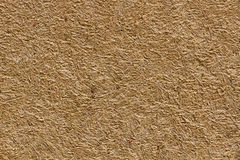 Wall adobe mud and straw. Texture or background wall ocher adobe mud mixed with straw baked in the sun royalty free stock image
