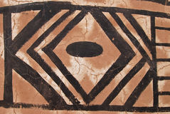 Wall with african tribal painting stock image