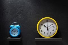 Wall and alarm clock at black background Stock Photo