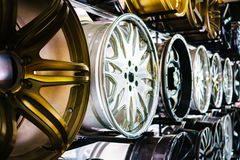 Wall of alloy car wheels in store Royalty Free Stock Photos