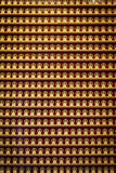 Wall of Amitayus Buddha figurines Stock Photography