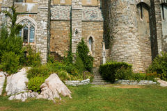 Wall of ancient castle with stairs and window Stock Photos