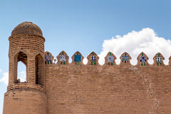 Wall of ancient fortress in Khiva. Brick wall ancient fortress city in Central Asia Khiva. Uzbekistan. Wall with a small tower and merlons (the pier) is stock photos