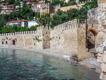 The wall of the ancient fortress at the sea coast in Alanya Stock Image