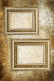 Wall with antique frames Stock Images