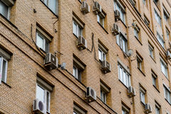 The wall of an apartment house with air conditioning royalty free stock photos