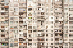 Wall of apartment house. Dirty wall of apartment house with many windows stock photography