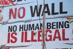Wall Art Decries Immigration Reform. Wall art in a Mexican neighborhood in Chicago denounces immigration reform policies Stock Image
