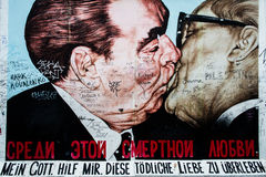 Wall art at East Side Gallery: Dmitri Vrubel. Famous graffiti art at East Side Gallery, Berlin.  Dmitri Vrubel 's My God, Help Me to Survive This Deadly Love Royalty Free Stock Images