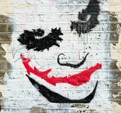 Wall art. The Joker. Artistic interpretation of the much loved comic book creation The Joker painted on a wall Royalty Free Stock Photos