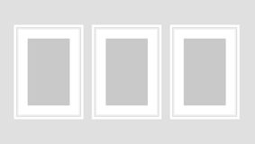 Wall art poster set of three white A4 frames. Stock Photo