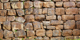 Wall assembled from a roughly processed natural stone Royalty Free Stock Photos