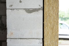 Wall with autoclaved aerated concrete blocks and mineral rockwool panel. Stock Photos