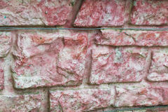 Wall background red white. Background of an old brick wall with red stones Stock Photo